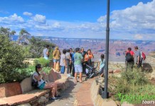 Tourists enjoy the amazing view behind the Bright Angel Lodge at the Grand Canyon National Park