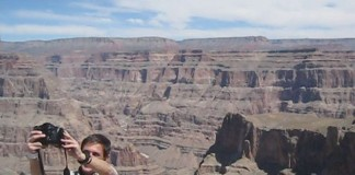 Great photo of a traveller capturing himself with the amazing view of the Grand Canyon West Rim