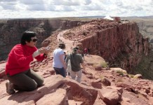 A tourist enjoys photographing and exploring the Grand Canyon West Rim