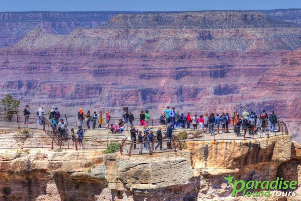 Tourists who've taken the Grand Canyon Airplane tour to the South Rim enjoy the views at Mather Point.