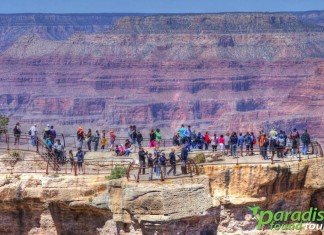 Tourists who've take the Grand Canyon Airplane tour to the South Rim enjoy the views at Mather Point.