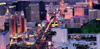 A helicopter flys above the Las Vegas Blvd at night